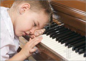 Young-Boy-Playing-Piano-1026299